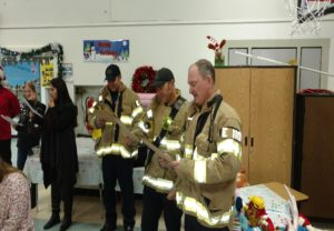 Members of International Association of Fire Fighters Local 522 visit & drop off toys to children at Starr King Elementary